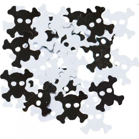 Konfetti mit schwarzen und weißen Totenköpfen