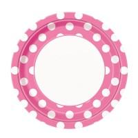 Rosafarbener Pappteller mit weißen Punkten